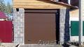Подъемные ворота с фальшапанелью для низких потолков